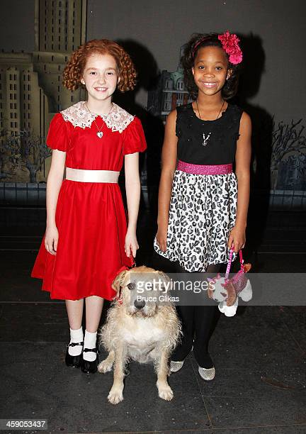 Taylor Richardson as Annie and Quvenzhané Wallis pose with Sandy backstage at Annie on Broadway at The Palace Theater on December 22 2013 in New York...