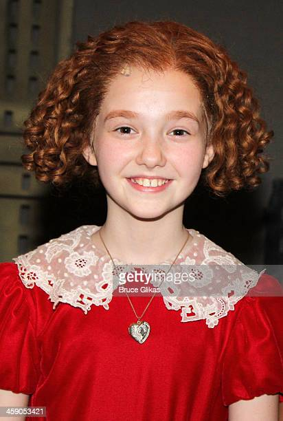 Taylor Richardson as 'Annie' poses backstage at 'Annie' on Broadway at The Palace Theater on December 22 2013 in New York City