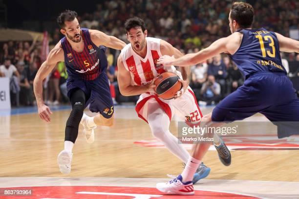 Taylor Rochestie #22 of Crvena Zvezda mts Belgrade competes with Pau Ribas #5 of FC Barcelona Lassa and Thomas Heurtel #13 of FC Barcelona Lassa in...