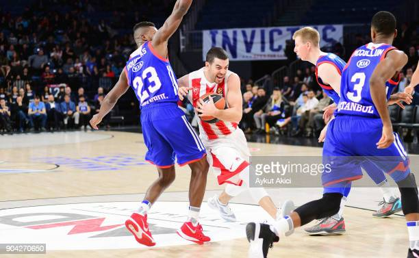 Taylor Rochestie #22 of Crvena Zvezda mts Belgrade competes with Toney Douglas #23 of Anadolu Efes Istanbul during the 2017/2018 Turkish Airlines...