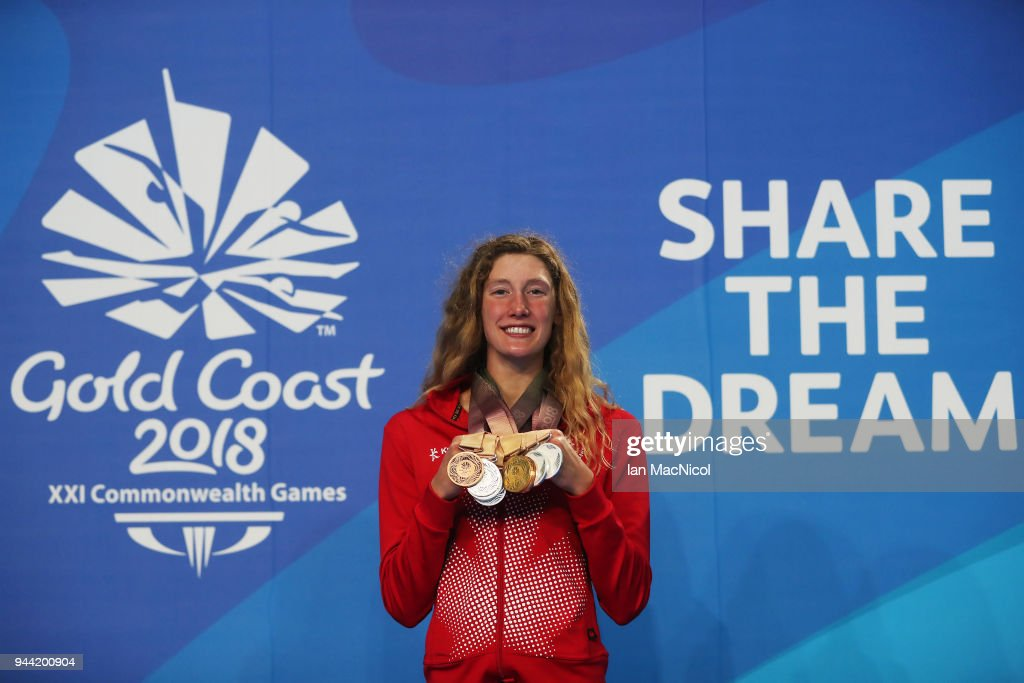 Taylor Ruck of Canada poses with the eight medals she won in the pool on day six of the Gold Coast 2018 Commonwealth Games at Optus Aquatic Centre on April 10, 2018 on the Gold Coast, Australia.