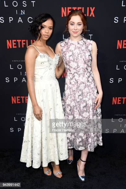Taylor Russell and Mina Sundwall attend the premiere of Netflix's Lost In Space Season 1 at The Cinerama Dome on April 9 2018 in Los Angeles...