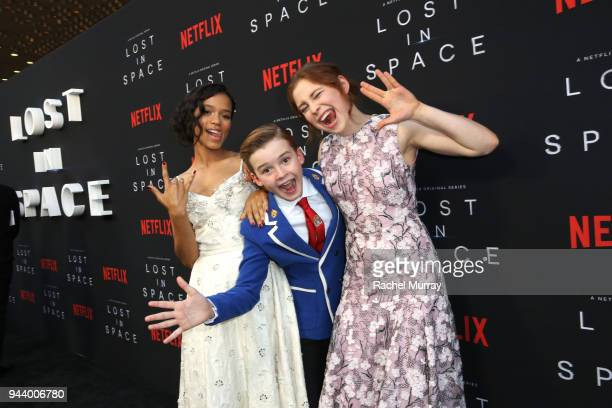 Taylor Russell Maxwell Jenkins and Mina Sundwall attend Netflix's 'Lost In Space' Los Angeles premiere on April 9 2018 in Los Angeles California