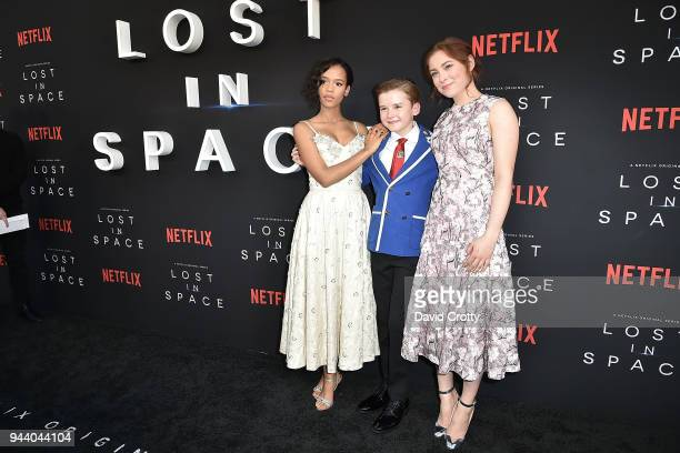 Taylor Russell Maxwell Jenkins and Mina Sundwall attend the 'Lost In Space' Season 1 Premiere at ArcLight Cinerama Dome on April 9 2018 in Hollywood...