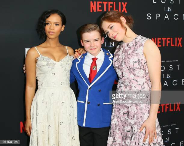 Taylor Russell Maxwell Jenkins and Mina Sundwall attend the premiere of Netflix's 'Lost In Space' Season 1 on April 9 2018 in Los Angeles California