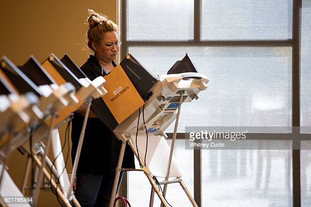 Taylor Salazar casts her electronic ballot on November 8 2016 in Olathe Kansas After a contentious campaign season Americans go to the polls today to...