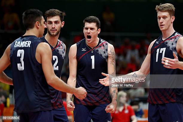 Taylor Sander Aaron Russell Matthew Anderson and Maxwell Holt of United States react to scoring against Poland during the Men's Quarterfinal...