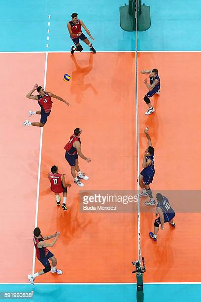Taylor Sander of United States spikes the ball against Italy during the Men's Volleyball Semifinal match on Day 14 of the Rio 2016 Olympic Games at...
