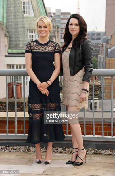 Taylor Schilling and Laura Prepon attend a photocall to launch season 2 of Netflix exclusive series 'Orange Is The New Black' at the Soho Hotel on...