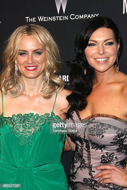 Taylor Schilling and Laura Prepon attend the Weinstein Company's 2014 Golden Globe Awards after party on January 12 2014 in Beverly Hills California