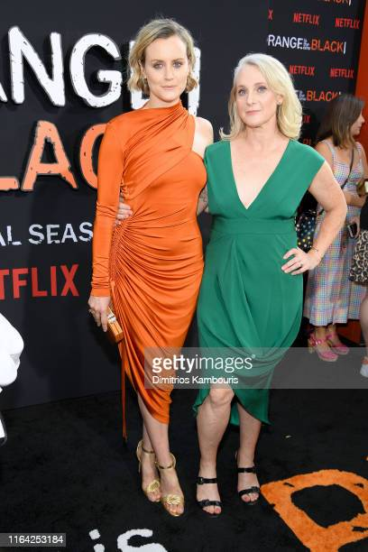 """Taylor Schilling and Piper Kerman attend the """"Orange Is The New Black"""" Final Season World Premiere at Alice Tully Hall, Lincoln Center on July 25,..."""