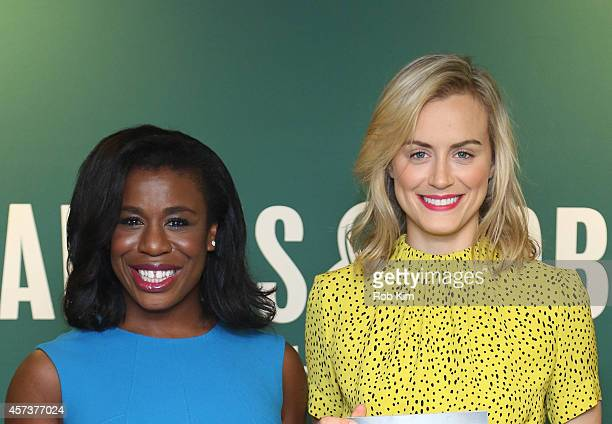 Taylor Schilling and Uzo Aduba promote Orange Is The New Black Presents The Cookbook Event at Barnes Noble 5th Avenue on October 17 2014 in New York...