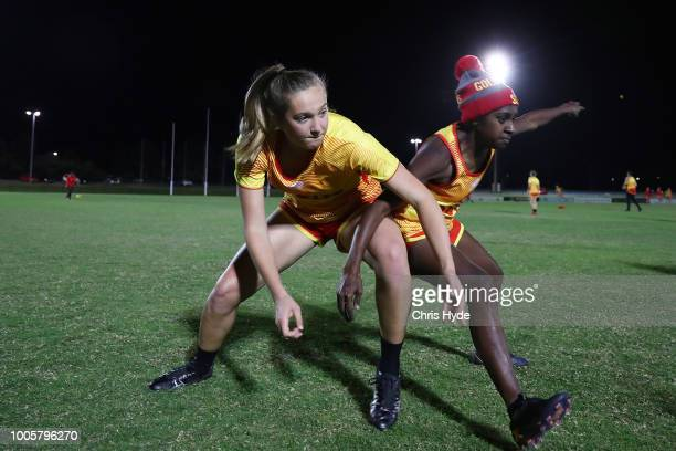 Taylor Smith and Delma Gisu compete for the ball during a Suns training session ahead of the round two AFLW Winter Series match between the Gold...