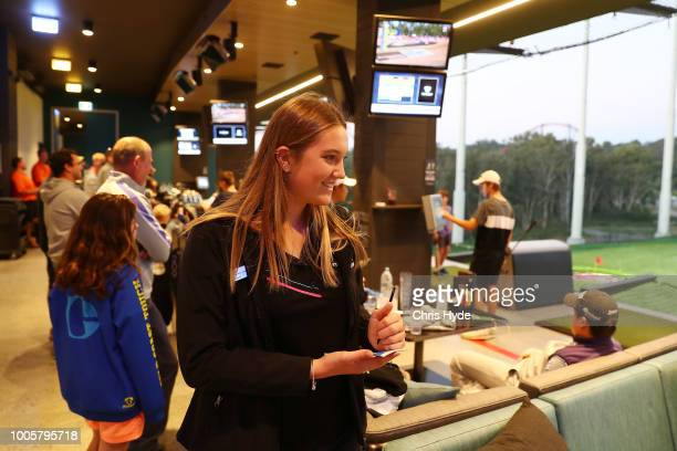 Taylor Smith at work at Top Golf Taylor has been playing in the Suns AFLW Winter Series team while studying and working on July 26 2018 in Gold Coast...