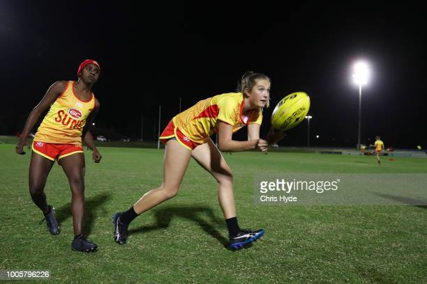 Taylor Smith handballs during a Suns training session ahead of the round two AFLW Winter Series match between the Gold Coast Suns and the Southern...