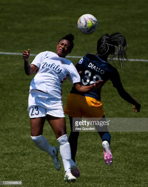 Taylor Smith of OL Reign attempts to head a ball against Aminata Diallo of Utah Royals FC during a game on day 6 of the NWSL Challenge Cup at Zions...