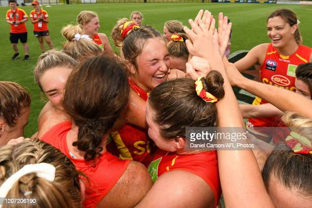 Taylor Smith of the Suns celebrate the win with the team during the 2020 AFLW Round 06 match between the West Coast Eagles and the Gold Coast Suns at...