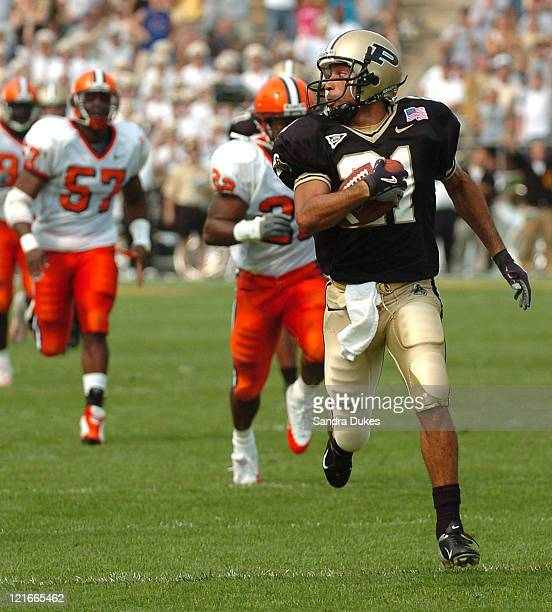 Taylor Stubblefield of Purdue runs past Syracuse defenders for a 67-yard touchdown run after a pass during the 51-0 defeat of Syracuse at Ross-Ade...