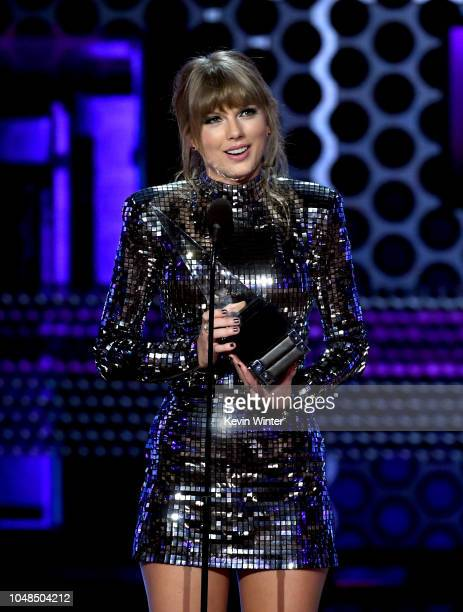 Taylor Swift accepts Artist of the Year onstage during the 2018 American Music Awards at Microsoft Theater on October 9 2018 in Los Angeles California