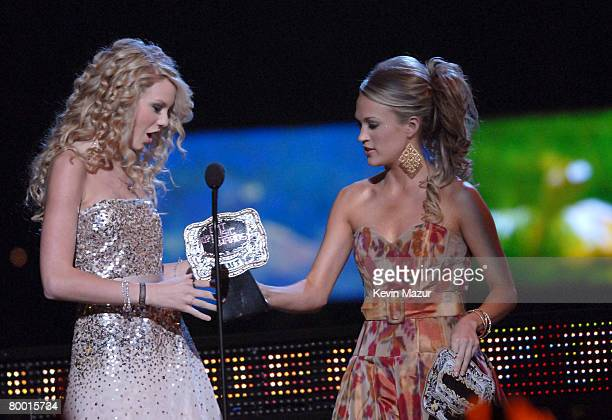 Taylor Swift accepts Breathrough Video of the Year award for Tim McGraw from presenter Carrie Underwood