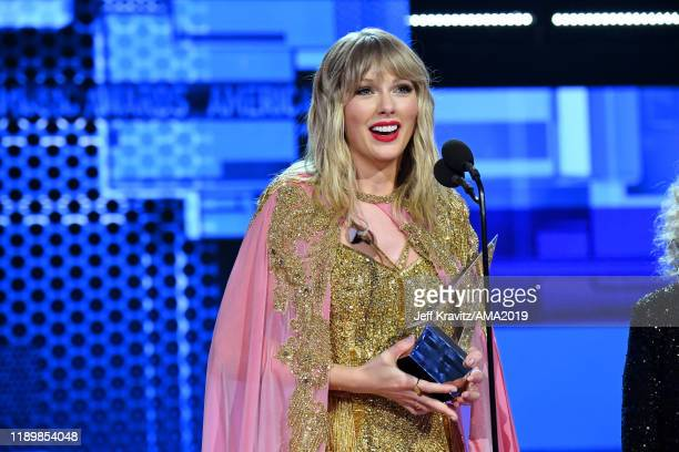 Taylor Swift accepts the Artist of the Decade award onstage during the 2019 American Music Awards at Microsoft Theater on November 24 2019 in Los...