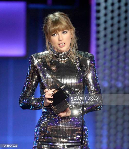 Taylor Swift accepts the Artist of the Year award onstage during the 2018 American Music Awards at Microsoft Theater on October 9 2018 in Los Angeles...