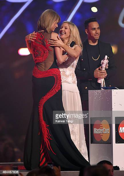 Taylor Swift accepts the award for Best International Solo Female Artist from Ellie Goulding and Lewis Hamilton at the BRIT Awards 2015 at The O2...