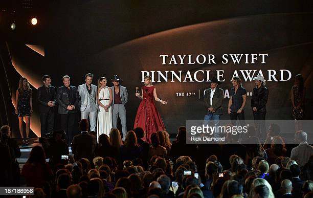 Taylor Swift accepts The CMA Pinnacle Award onstage presented by Jay DeMarcus Joe Don Rooney and Gary LeVox of Rascall Flatts Faith Hill Tim McGraw...
