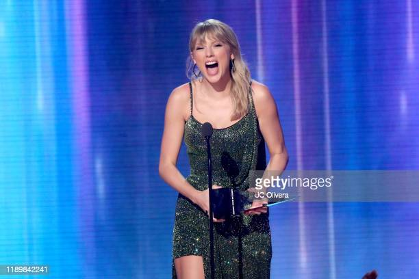 Taylor Swift accepts the Favorite Album Pop/Rock award for 'Lover' performs onstage during the 2019 American Music Awards at Microsoft Theater on...
