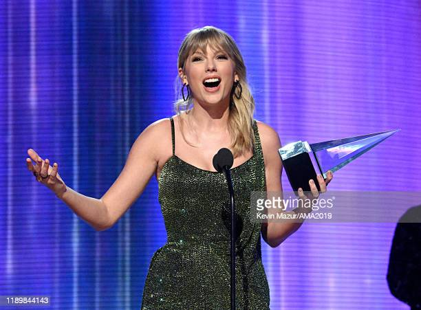 Taylor Swift accepts the Favorite Album - Pop/Rock award for 'Lover' onstage during the 2019 American Music Awards at Microsoft Theater on November...