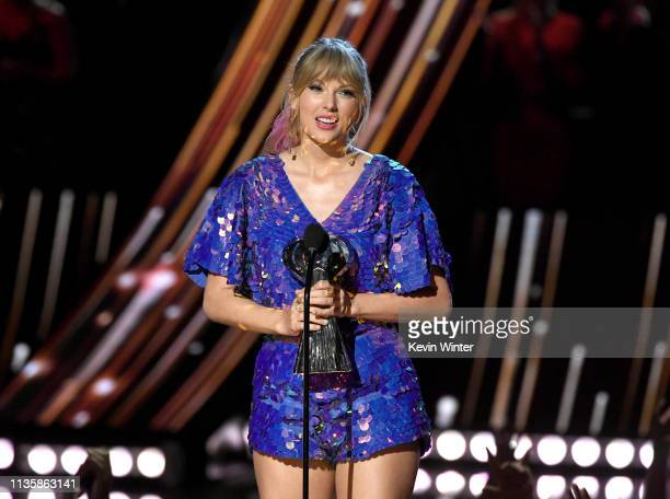 Taylor Swift accepts the Tour of the Year award for Reputation Stadium Tour on stage at the 2019 iHeartRadio Music Awards which broadcasted live on...