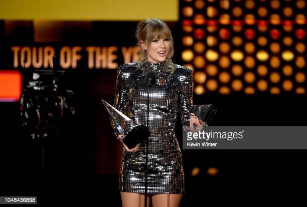Taylor Swift accepts Tour of the Year for the Reputation Stadium Tour onstage during the 2018 American Music Awards at Microsoft Theater on October 9...