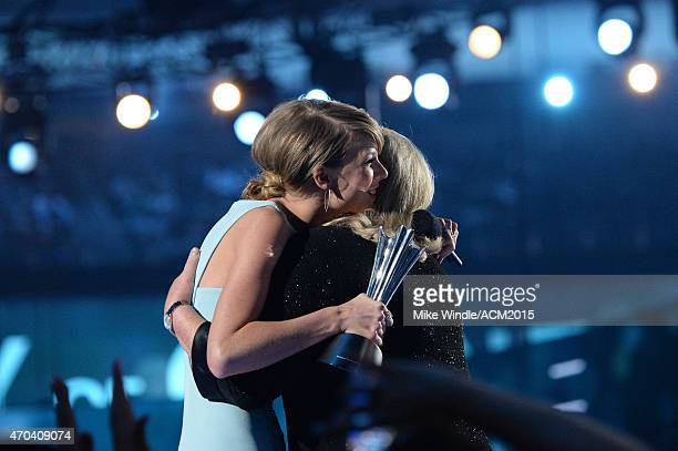 Taylor Swift and Andrea Swift hug onstage during the 50th Academy of Country Music Awards at ATT Stadium on April 19 2015 in Arlington Texas
