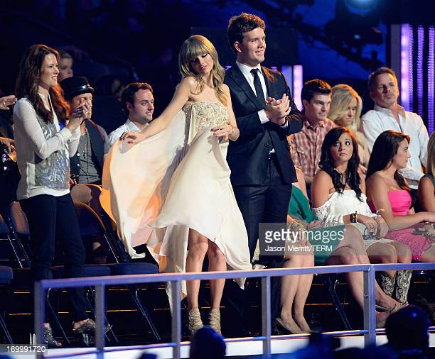 Taylor Swift and Austin Swift attend the 2013 CMT Music awards at the Bridgestone Arena on June 5 2013 in Nashville Tennessee