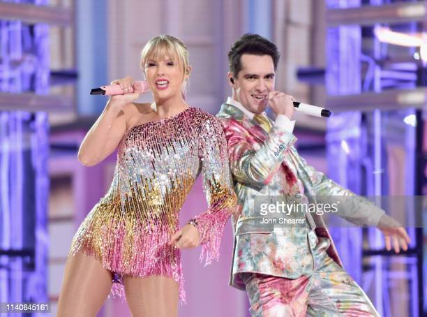 Taylor Swift and Brendon Urie perform onstage during the 2019 Billboard Music Awards at MGM Grand Garden Arena on May 1 2019 in Las Vegas Nevada