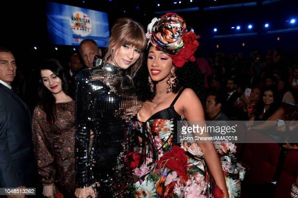Taylor Swift and Cardi B attend the 2018 American Music Awards at Microsoft Theater on October 9 2018 in Los Angeles California