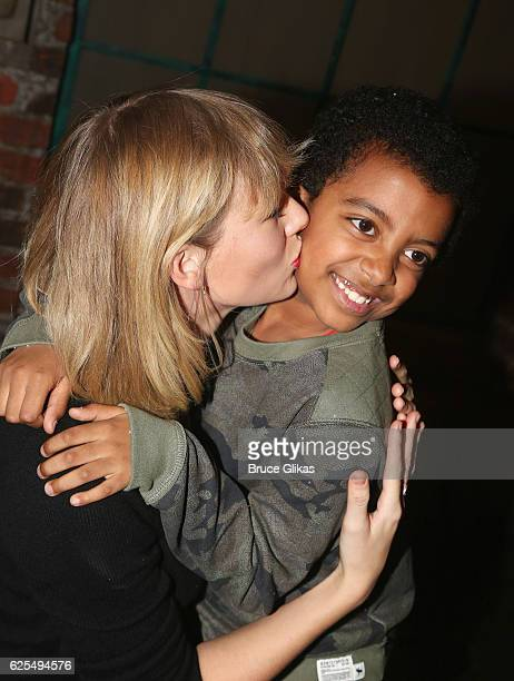 Taylor Swift and Devin Trey Campbell pose backstage with the cast at the hit musical Kinky Boots on Broadway at The Al Hirschfeld Theater on November...