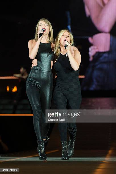 Taylor Swift and Ellie Goulding perform onstage during the 1989 World Tour Live on October 17 2015 at the ATT Stadium in Arlington Texas