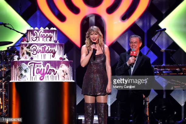 Taylor Swift and Elvis Duran onstage during iHeartRadio's Z100 Jingle Ball 2019 at Madison Square Garden on December 13, 2019 in New York City.
