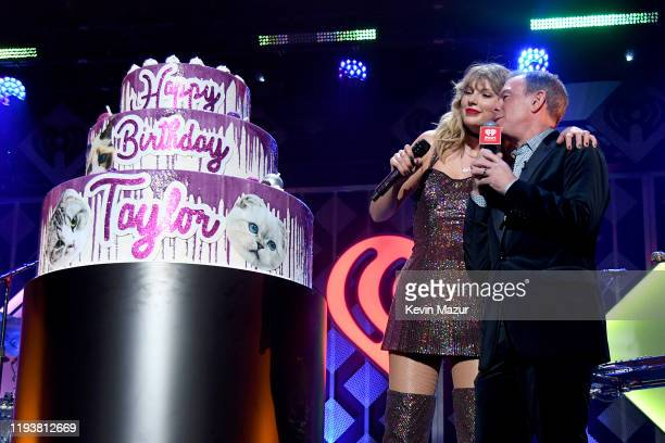 Taylor Swift and Elvis Duran pose onstage during iHeartRadio's Z100 Jingle Ball 2019 at Madison Square Garden on December 13 2019 in New York City