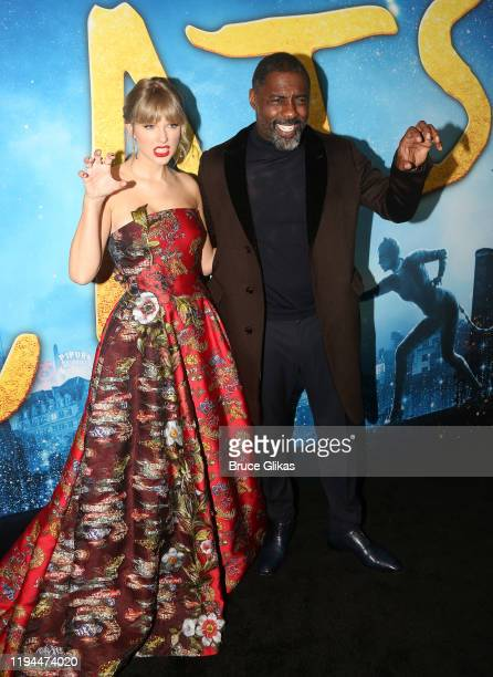 "Taylor Swift and Idris Elba pose at the World Premiere of the new film ""Cats"" based on the Andrew Lloyd Webber musical at Alice Tully Hall, Lincoln..."