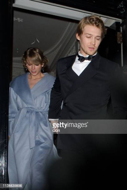 Taylor Swift and Joe Alwyn seen attending the Vogue BAFTA party at Annabel's club in Mayfair on February 10 2019 in London England
