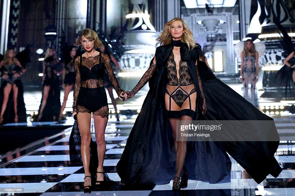Taylor Swift and Karlie Kloss on the runway at the 2014 Victoria's Secret Runway Show - Swarovski Crystal Looks at Earl's Court Exhibition Centre on December 2, 2014 in London, England.