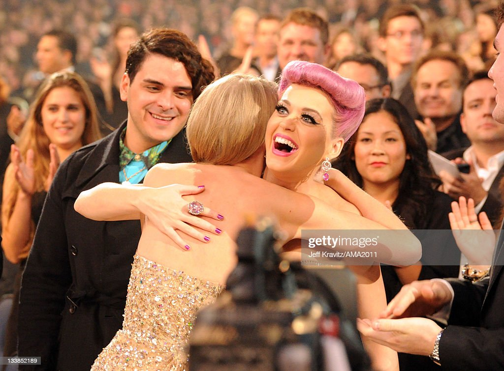 Taylor Swift and Katy Perry hug at the 2011 American Music Awards held at Nokia Theatre L.A. LIVE on November 20, 2011 in Los Angeles, California.