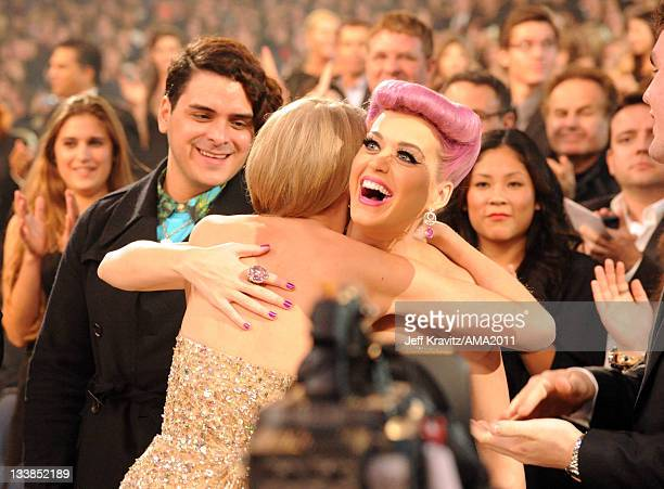 Taylor Swift and Katy Perry hug at the 2011 American Music Awards held at Nokia Theatre LA LIVE on November 20 2011 in Los Angeles California