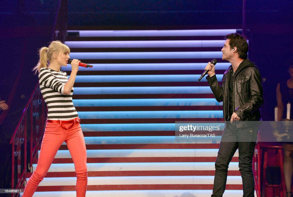 Taylor Swift and Pat Monahan perform onstage at the Prudential Center on March 29, 2013 in Newark, New Jersey. Seven-time GRAMMY winner Taylor Swift plays 3 sold-out NY area shows at the Prudential Center this week on The RED Tour. Taylor plays electric guitar, banjo, piano and acoustic guitar and changes costumes 10 times over the course of the evening. The North American portion of The RED Tour will play 66 shows (including 13 stadium stops) in 47 cities in 29 states and 3 provinces spanning 6 months in 2013.