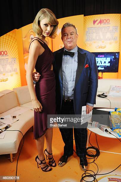 Taylor Swift and radio personality Elvis Duran pose backstage at iHeartRadio Jingle Ball 2014 hosted by Z100 New York and presented by Goldfish Puffs...