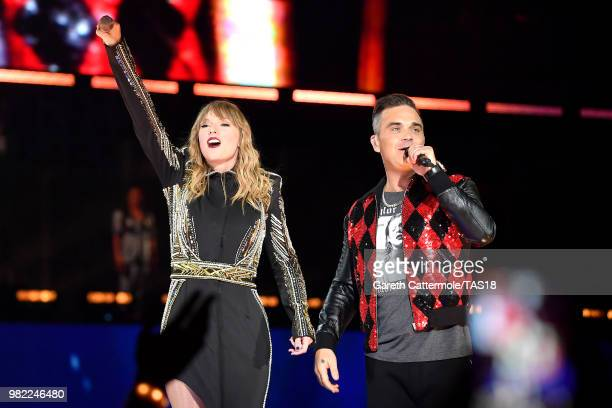 Taylor Swift and Robbie Williams perform on stage during the reputation Stadium Tour at Wembley Stadium on June 23 2018 in London England