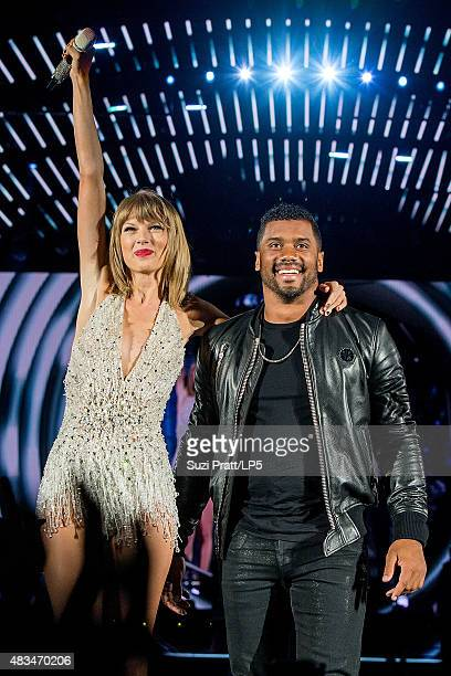 Taylor Swift and Russell Wilson perform at CenturyLink Field on August 8 2015 in Seattle Washington
