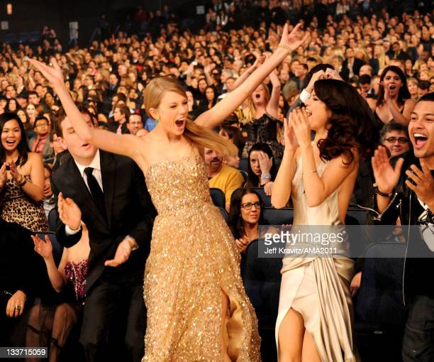 Taylor Swift and Selena Gomez celebrate her winning an award at the Nokia Theatre LA LIVE on November 20 2011 in Los Angeles California